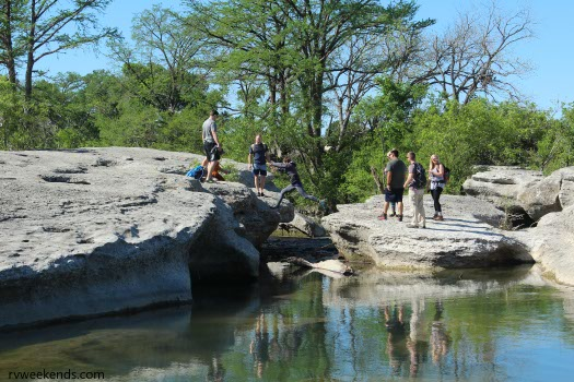McKinney Falls Hikers Crossing Onion Creek